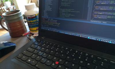 Laptop with coffee and pills